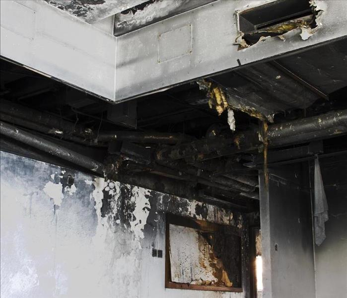 Inside of a building damaged by fire, ceiling and walls. Empty building