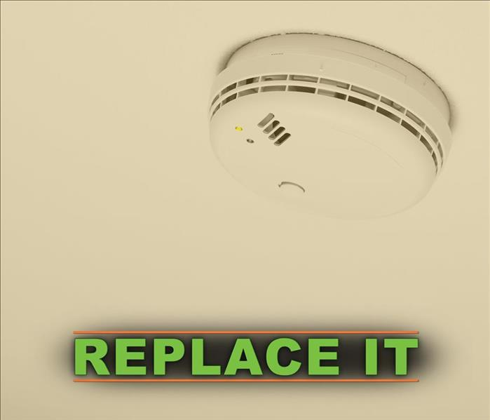 Smoke alarm with the word REPLACE IT