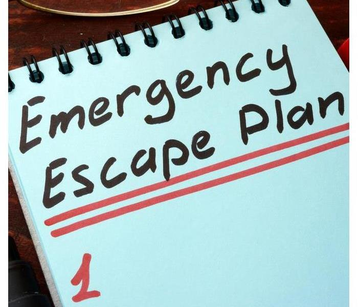 A notebook that says emergency escape plan